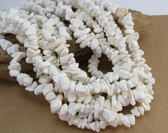 White Magnesite Chips, Medium Magnesite Chips, 34 inch Strand, Item 988gsm