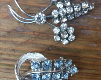 two vintage blue and white rhinestone brooches