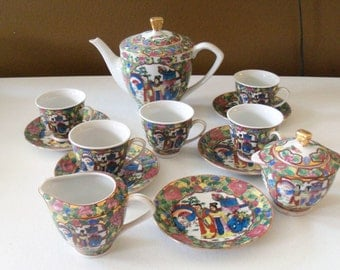 Chinese Tea Or Coffee Pot With Cream And Sugar And Five Cups & Saucers