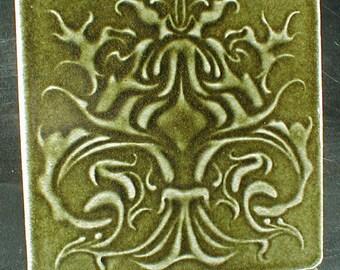 Art nouveau tile with dark olive green glaze, wall hanging, art tile, wall art, home decor, ceramic sculpture, ceramic art,