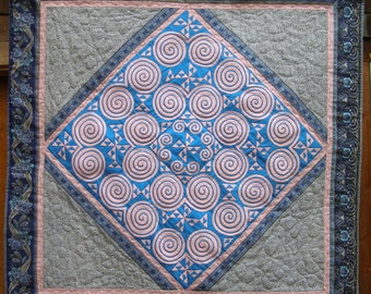 Hmong applique in square quilted mat
