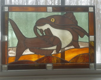Stained Glass Prowling Catfish in Murky Water