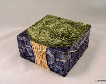 Ceramic case with tree relief