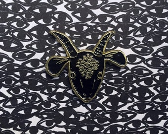 gold & black GOATEYES - enamel pin