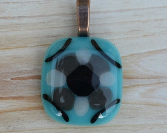 Necklace: Light Blue Fused Glass Pendant with Black, Gray, & White Embellishments