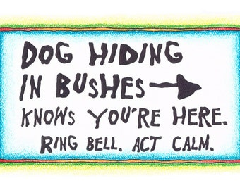 Dog Hiding In Bushes Laminated Sign