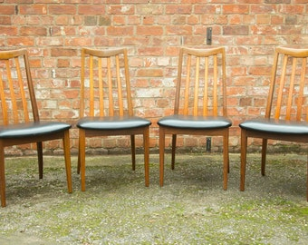 4 x Retro  G Plan teak dining chairs in black leatherette