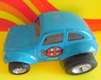 Buddy L, Made in Japan, VW Beetle Bug.  It has over-sized tires, and is made of metal