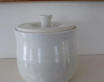 Cream colored sugar bowl or small lidded jar.