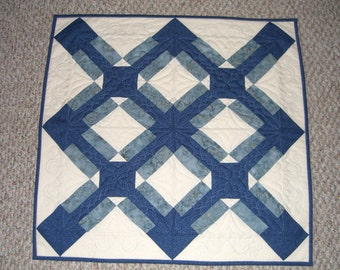 Blue cross quilted table topper