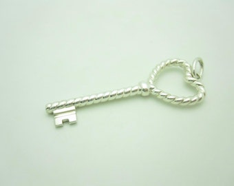 Tiffany & Co. Sterling Silver Braided Rope Heart Key Pendant