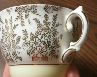 Pre 1953 Royal Vale teacup/ gold and pale yellow/ flowers
