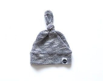Gray textured top knot beanie