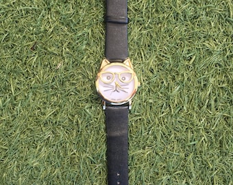 Black strap cat with classes watch