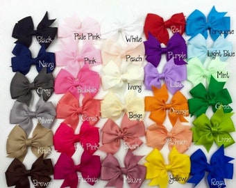 Baby girls mini bow hair clip. Ribbon bow hair clip. Grosgain ribbon clip. Alligator clip.