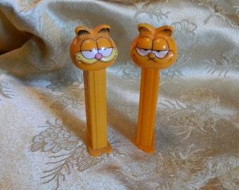 Vintage Garfield Pez Dispenser in Two Different Styles.