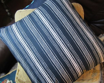 Blue and white striped throw pillow with navy blue cording