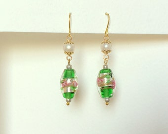 A pair of earrings with Green Venetian beads
