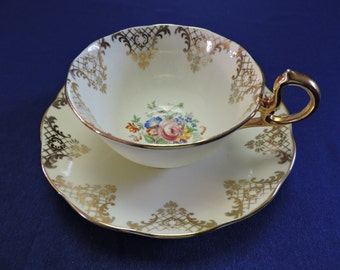 Royal Albert Bone China Tea Cup and Saucer Set White With Heavy Gold Floral Center