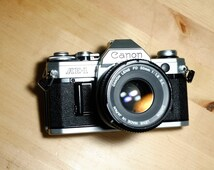 Canon AE-1 - Vintage SLR Camera - Nice, Working Condition - with Canon Lens FD 50 1.8 S.C.