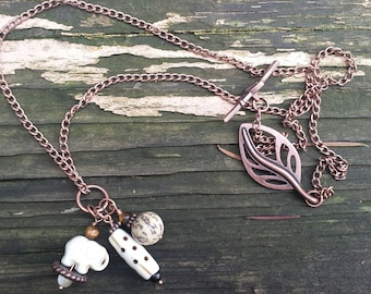 Creamy Elephant, Horn and Seed Charm Necklace