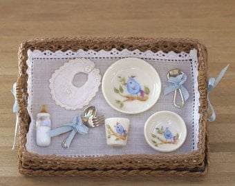 Basket with dinnerware and baby accessories, 1:12 scale, dollhouse miniature . Artisan.