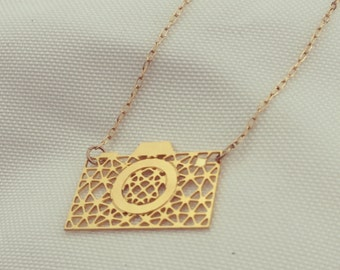 MIZYAN's geometric camera necklace, geometric accessories