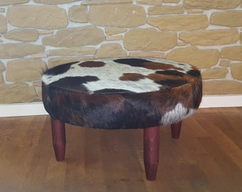 round cowhide footstool, ottoman, available now!
