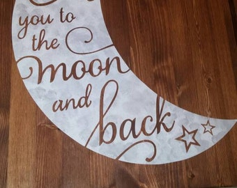 Love you to the moon wood sign.
