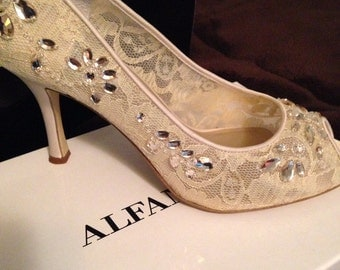 Cream Wedding Shoes worn once, size 7.5, peep toe.