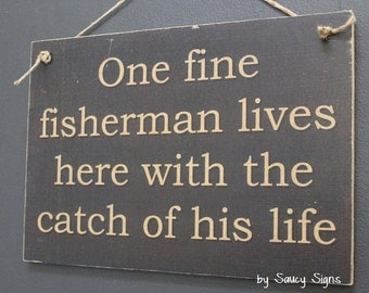 One Fine Fisherman Lives Here With The Catch of His Life Sign