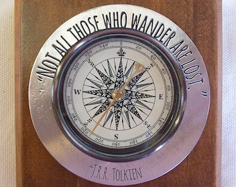 """Decorative Compass with inspirational saying - """"Not all those who wander are lost.""""  JRR Tolken."""