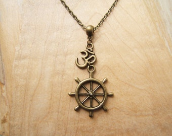 Buddhist Dharma /wheel of life and Om, Aum symbol necklace in bronze tone.