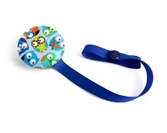 Attached to pacifiers blue owls