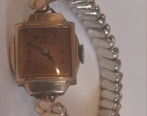 Benrus Vintage Ladies Watch Model 307524 Copper Color Stretch watch with copper color face - manual wind watch in excellent WORKING conditio