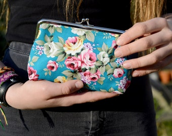 Small clutch purse in turquoise and pink floral cotton with silver coloured metal kiss-lock clutch purse frame