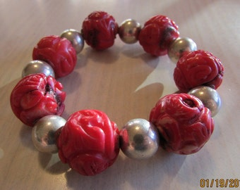 Dyed Carved Coral and Sterling Silver Bead Stretch Bracelet