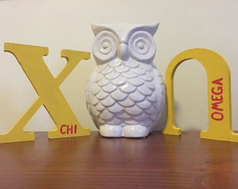 Handpainted chi omega letters.