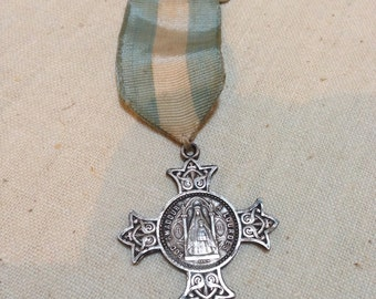 Lourdes medal on a ribbon