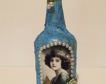 Blue altered bottle with vintage girl photo