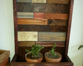 Reclaimed wood wall planter stained