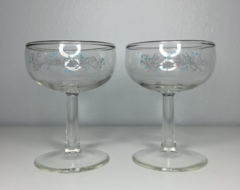set of two vintage silver-rimmed champagne glasses with flowers