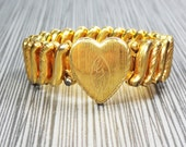 Vintage Style Jewelry, Retro Jewelry Sale  Vintage Heart Bracelet 1940s Gold Plated Expansion Bracelet Dolly Madison Marathon Bracelet in Box Sweetheart Bracelet Small Size $33.00 AT vintagedancer.com
