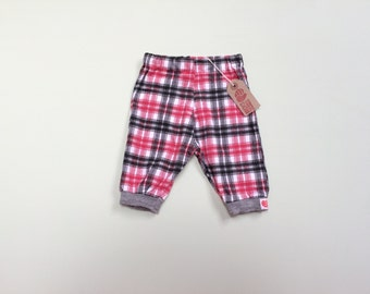 Red, white and black checked baggy pants. 0-3 months