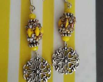 "a pairs of earrings ""softness d a Sun"""