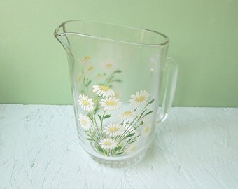 Vintage water jug with a flower design, daisies.