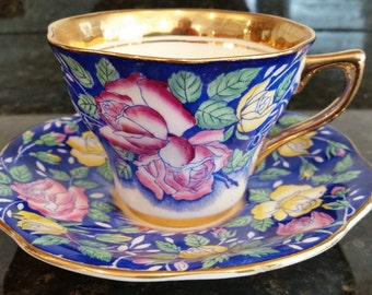 Teacup and Saucer Rosina Gold Banded Cobalt Blue with Pink and yellow Roses, Rare Floral Tea Cup Made in England 4861