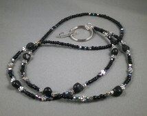 """Black turquoise skulls and crystal ID lanyard . Your choice of lenght 32"""" to 42"""" and attachment ,ID,key or eyeglasses"""