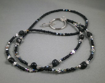 "Black turquoise skulls and crystal ID lanyard . Your choice of lenght 32"" to 42"" and attachment ,ID,key or eyeglasses"