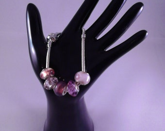 Bracelet with pink glass charms on a 19cm chain